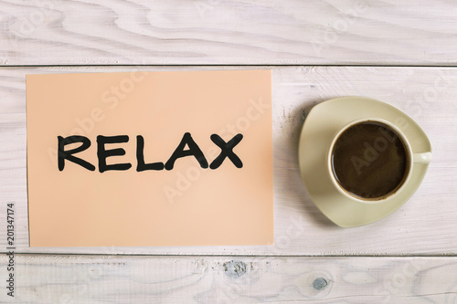 Word relax with cup of coffee  on wooden table. - 201347174