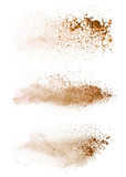 Abstract colored brown powder explosion isolated on white background. - 201348748