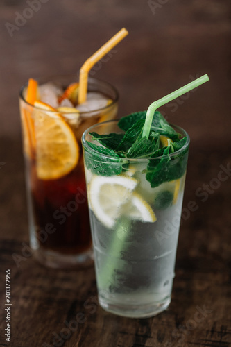 Foto Murales Two glasses of lemonade on a wooden background