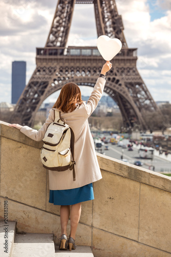 girl on the background of the Eiffel Tower - 201383198