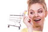 Woman holding shopping cart - 201393504