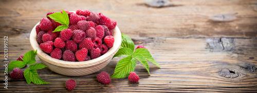 Fresh raspberries in the bowl - 201399752