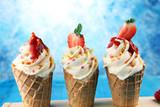 Vanilla frozen yogurt or soft ice cream in waffle cone. - 201405393