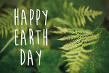 happy earth day text, concept. beautiful fern leaf and moss  in woods. fern leaves in sunny forest. environmental protection . earth protection - 201407989