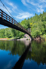 Swinging bridge over the mouth of the Black River in Michigan n