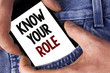 Word writing text Know Your Role. Business concept for define position in work or life Career Life goals active written on Mobile phone holding by man on the Jeans background.