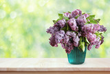 Bouquet of lilacs on a wooden table. Flowers in a vase. - 201467979