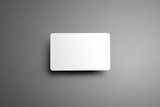 Universal blank mockup  one bank (gift) card with shadows on a gray background.