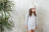 Children's fashion. Stylish baby girl in grey dress - 201481768