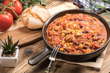 Chili con carne in a clay pan. - 201486342