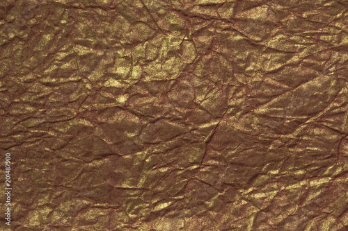 Golden textured paper background with glowing sparkles