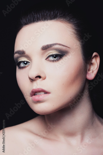 Foto Murales Beauty portraits with young girl in studio with black background