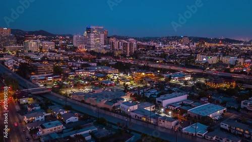 4K aerial cityscape at dusk