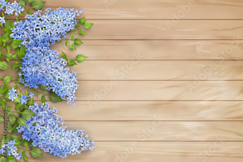 Lilac on wooden background