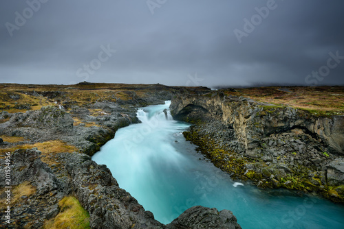 Godafoss, waterfall of the gods, is one of the most spectacular waterfalls in Iceland. Amazing landscape at sunrise. Popular tourist attraction. Unusual and picturesque scene. - 201524956