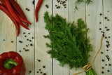 Fresh dill bunch on wooden table background. Organic dill closeup on rustic wooden table, vegetarian food background. - 201537364