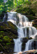 cascades of big waterfall in forest. beautiful summer scenery at sunrise. beams of light on water splashes. nature power and beauty concept - 201546762