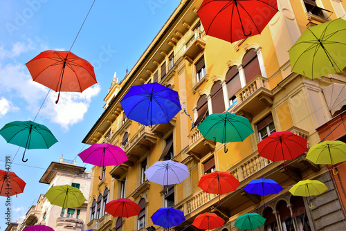 colorful umbrellas in the historic center of Genoa Italy