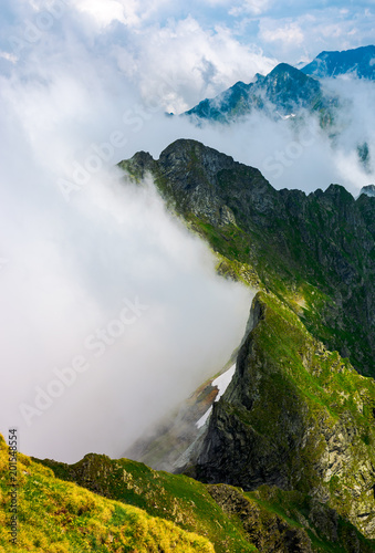 clouds rising in Fagaras mountains. beautiful summer scenery of Southern Carpathians