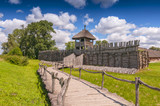 Reconstruction of the defensive shaft and gate to the Lusatian settlement in archeological museum in Biskupin, Poland. - 201554178