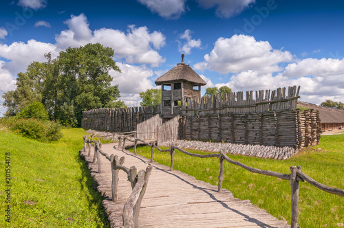 Reconstruction of the defensive shaft and gate to the Lusatian settlement in archeological museum in Biskupin, Poland.
