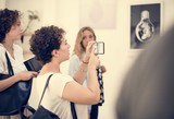 people checking out the exhibition - 201574768