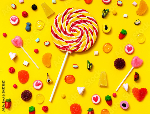 Foto Murales colorful candy on the yellow background