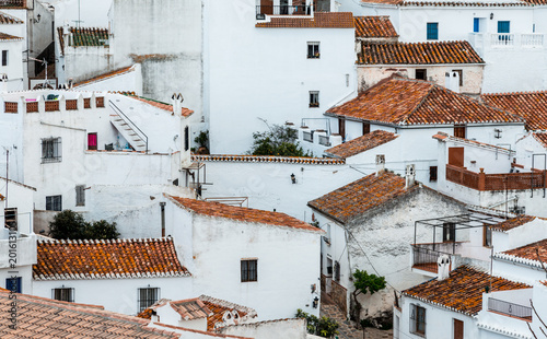 View of an old spanish town. White facades and reddish-brown roofs
