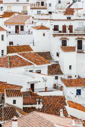 Sticker View of an old spanish town. White facades and reddish-brown roofs