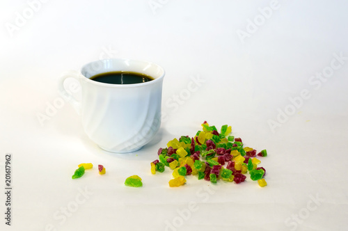 Wall mural different candied fruits and coffee Cup on white background