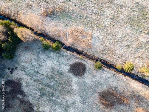 drone image. aerial view of rural area with swamps, lakes and forests - 201625132