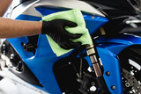 A man cleaning motorcycle with cloth. Selective focus.  - 201631160