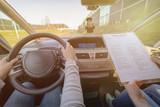 Examiner filling in driver's license road test form - 201636146