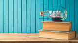 Boat and books on wooden table - 201637945