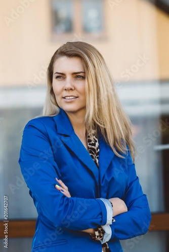 Foto Murales Young elegant business woman in blue jacket.