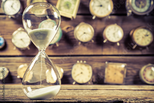 Vintage hourglass on background made of clocks - 201643954