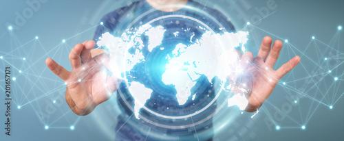 Foto Murales Businessman using digital world map interface 3D rendering