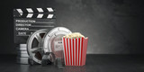 Cinema movie concept  background. Film reel and tape, popcorn and clapperboard on black grunge background - 201663796