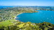 Aerial view on sunny beach with residential houses. Waiheke Island, Auckland, New Zealand - 201681300