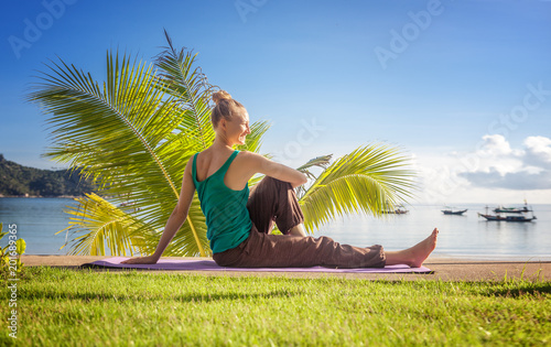 Poster Young woman doing yoga outdoors. Healthy lifestyle, meditation, lifestyle concept