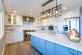 Beautiful white kitchen with large island. - 201699739