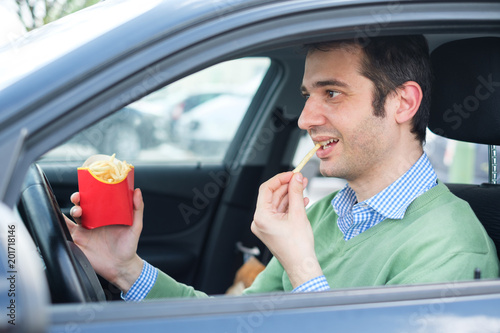 Car driving and cigarette smoking concept.Man at the wheel with cigarette