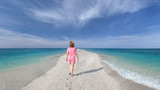 Single woman on open empty long shore as spirituality concept