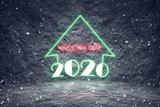 Snowing 2020 christmas holiday with colorful neon lights