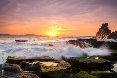 Fototapeta amazing sunset landscape at rocky beach