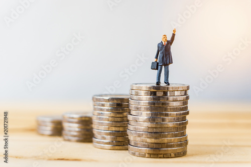 Businessman miniature standing on stack