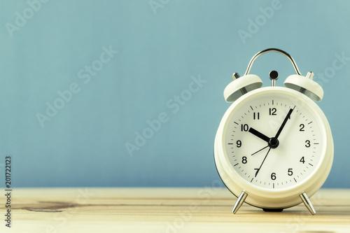 retro alarm clock on wood table