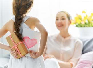 daughter is congratulating mom © Konstantin Yuganov