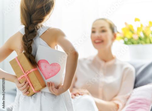 Fototapeta daughter is congratulating mom