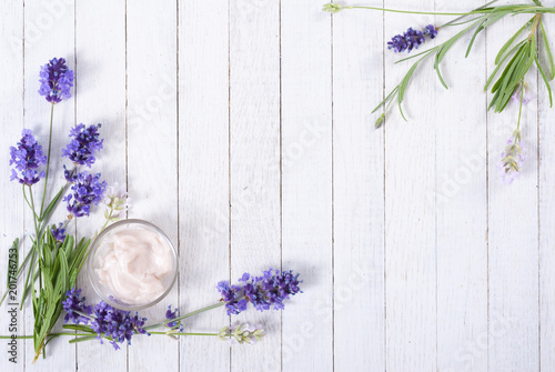 cosmetic cream and lavender flowers on white wood table background - 201746753